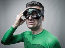 Superhero med dålig huvudvärk Royaltyfri Fotografi