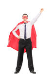 Superhero met opgeheven vuist Royalty-vrije Stock Afbeeldingen