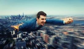 Superhero over the city stock photo