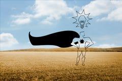 Superhero over countryside Royalty Free Stock Image