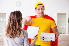 The superhero pizza delivery guy with red cover Royalty Free Stock Image