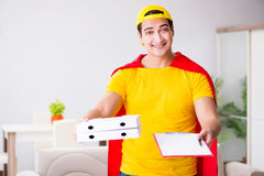 The superhero pizza delivery guy with red cover. Superhero pizza delivery guy with red cover Royalty Free Stock Photography