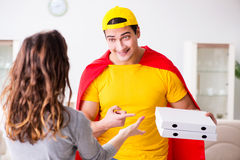 The superhero pizza delivery guy with red cover Stock Photo