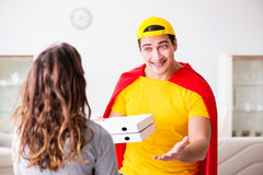 The superhero pizza delivery guy with red cover Stock Photos