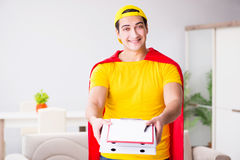 The superhero pizza delivery guy with red cover. Superhero pizza delivery guy with red cover Royalty Free Stock Images