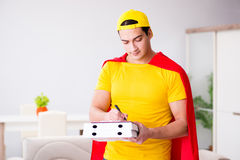 The superhero pizza delivery guy with red cover. Superhero pizza delivery guy with red cover Stock Photography