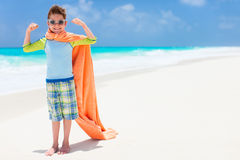 Superhero play at a beach Stock Image