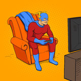 Superhero playing the game console vector Stock Photo