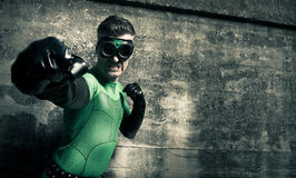 Superhero punching his enemy Royalty Free Stock Image