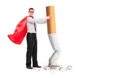 Superhero putting out a giant cigarette. Isolated on white background Royalty Free Stock Images