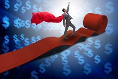 The superhero on the red carpet in success concept. Superhero on the red carpet in success concept Stock Image