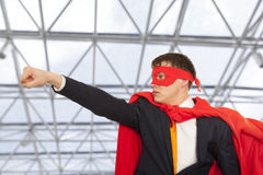 Superhero in a red cloak Stock Photos