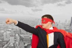 Superhero in a red cloak. Businessman superhero in a red cloak. Business concept stock photo