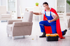 The superhero repairman with tools in repair concept Royalty Free Stock Photography