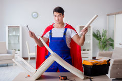The superhero repairman with tools in repair concept Stock Image