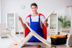 The superhero repairman with tools in repair concept Royalty Free Stock Images