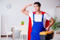 The superhero repairman with tools in repair concept Royalty Free Stock Photo
