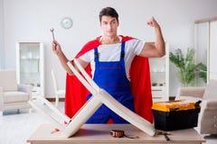 The superhero repairman with tools in repair concept Stock Photos