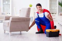 The superhero repairman with tools in repair concept Royalty Free Stock Image