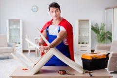The superhero repairman with tools in repair concept Royalty Free Stock Photos