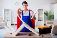 The superhero repairman with tools in repair concept Stock Photography