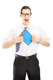 Superhero screaming and opening shirt, blank blue t-shirt undern Royalty Free Stock Photography