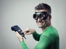 Superhero shopping with credit card royalty free stock photos