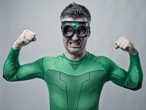 Superhero showing biceps Stock Images