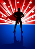 Superhero. Silhouette illustration of a superhero standing in front of light burst Royalty Free Stock Photo
