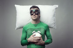 Superhero sleeping on a pillow floating in the air Royalty Free Stock Photo