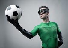 Superhero with soccer ball Royalty Free Stock Image