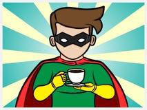 Superhero som rymmer en kaffekopp Royaltyfri Fotografi
