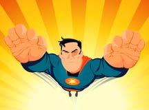 Superhero soufflant hors fonction Photographie stock libre de droits