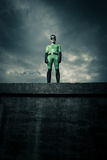 Superhero standing on a concrete wall Royalty Free Stock Photo