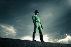 Superhero standing on a concrete wall Royalty Free Stock Photos