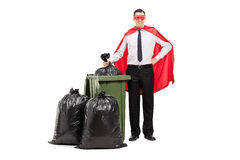 Superhero standing by a trash can Royalty Free Stock Image