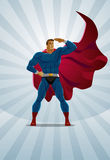 Superhero stands on the sunrise background Royalty Free Stock Image