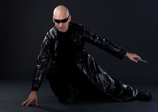 Superhero starting. Bald-headed superhero in black mackintosh Stock Image