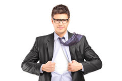 Superhero in a suit tearing his shirt Stock Image