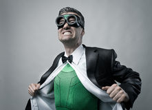 Superhero taking off shirt and jacket Royalty Free Stock Photos