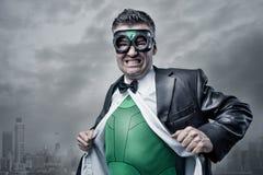 Superhero taking off shirt and jacket Stock Images