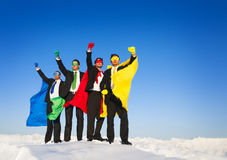 Superhero Team Arms Raised in Winter Royalty Free Stock Photos