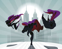 Superhero Team; Team of superheroes, flying and running in front. Of a urban background Royalty Free Stock Photos