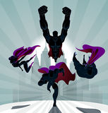 Superhero Team; Team of superheroes, flying and running in front Royalty Free Stock Photo