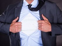 Superhero tearing off his shirt Royalty Free Stock Image