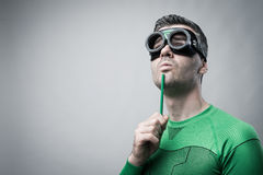 Superhero thinking with green pencil Stock Photography