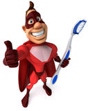 Superhero and toothbrush Royalty Free Stock Photography