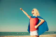 Superhero woman on the beach. Summer vacation concept Royalty Free Stock Images