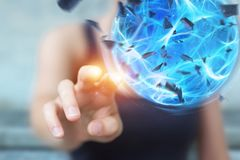 Superhero woman creating a power ball with her hand 3D rendering. Superhero woman creating an exploding blue power ball with her hand 3D rendering Royalty Free Stock Photos