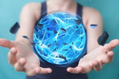 Superhero woman creating a power ball with her hand 3D rendering. Superhero woman creating an exploding blue power ball with her hand 3D rendering Royalty Free Stock Images